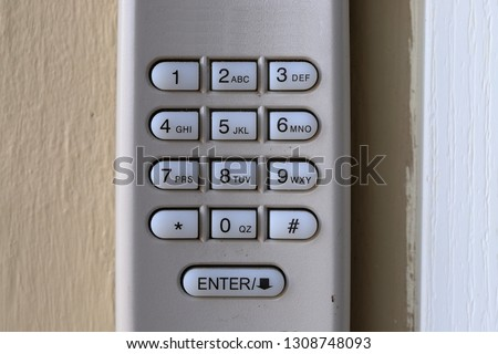Code Keypad used on a garage door entrance to a home - security keypad - security code #1308748093