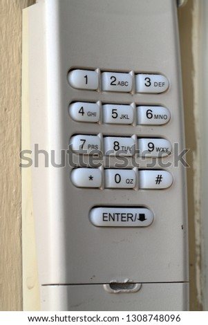 Code Keypad used on a garage door entrance to a home - security keypad - security code #1308748096
