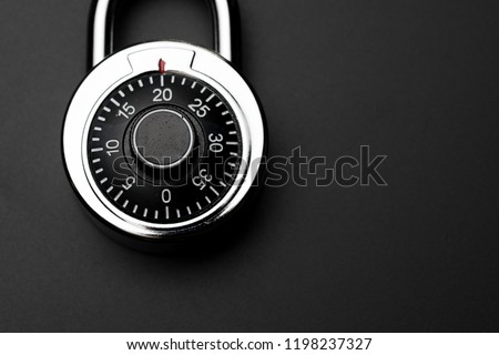 Code numbers on combination pad lock on dark black background with copy space, locking device in which a sequence of symbols or numbers used to open the lock, safety or security concept.