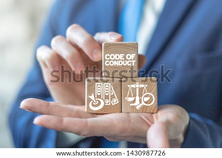 Code of conduct business concept on wooden blocks in businessman hands. Ethics and respect in working collective. Сток-фото ©