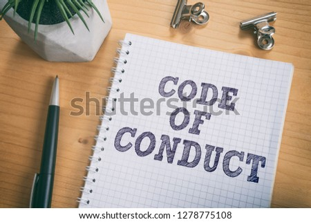 Code of Conduct text on notebook. Concept of ethical integrity, value and ethics. #1278775108