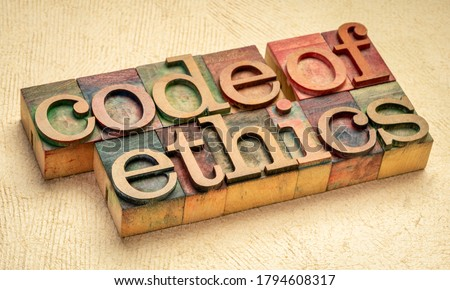 code of ethics text in vintage letterpress wood type printing blocks stained by color inks, values, ethical principles, and standards concept Stock photo ©