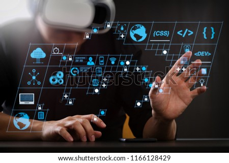 Coding software developer work with AR new design dashboard computer icons of scrum agile development and code fork and versioning with responsive cybersecurity.businessman wearing VR goggles
