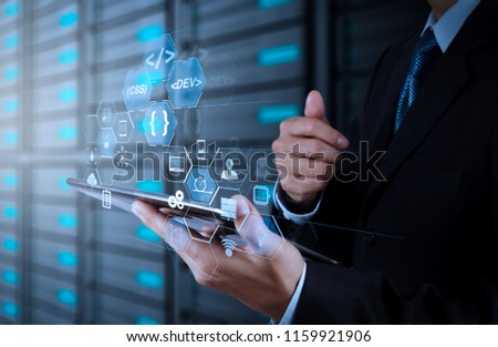 Coding software developer work with augmented reality dashboard computer icons of scrum agile development and code fork and versioning with responsive cybersecurity.businessman hand using  computer. #1159921906
