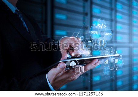 Coding software developer work with augmented reality dashboard computer icons of scrum agile development and code fork and versioning with responsive cybersecurity.businessman hand using tablet #1171257136