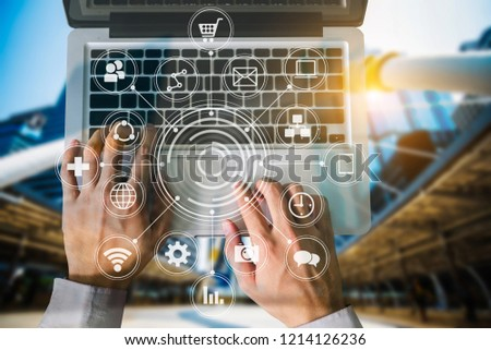 Coding software developer work with augmented reality dashboard computer icons  with responsive cybersecurity.Businessman hand working. #1214126236