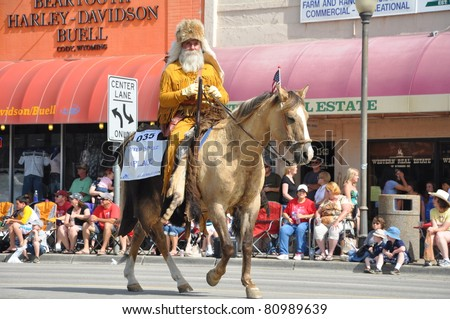 CODY, WYOMING -JULY 4:A traditionally dressed mountain man rides in the 92nd annual Cody Stampede Fourth of July parade in Cody, Wyoming on July 4, 2011.