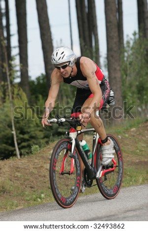 COEUR D'ALENE, IDAHO, JUNE 21: Triathlete Balazs Csok of Hungary on the bike portion of the Coeur d'Alene Ironman Triathlon in northern Idaho on June 21, 2009,