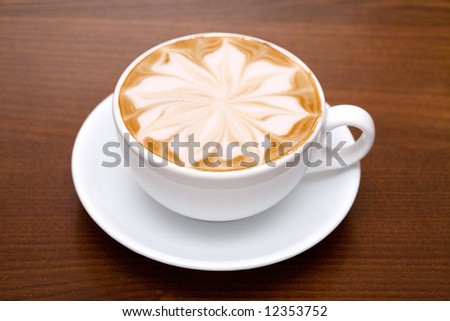 Cofee cup with coffee beans background