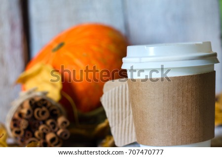 coffe, autumn leaves on wooden background. Concept autumn.
