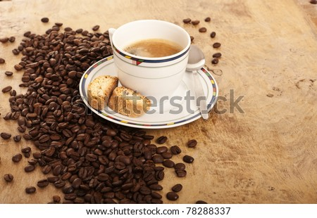 Coffe cup over coffee beans
