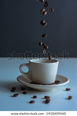 Coffe cup with coffe beans #1418609660