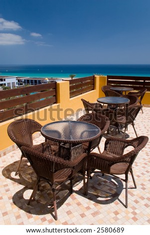 Coffe table with four rattan chairs
