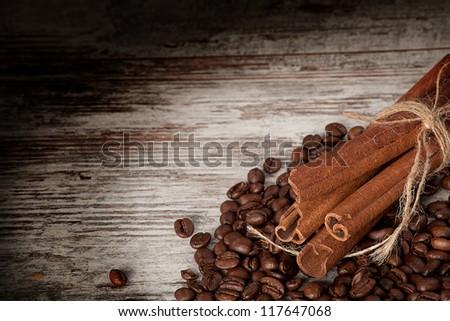 coffee and cinnamon over grunge wood