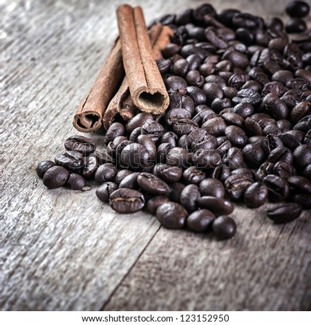 coffee and cinnamon over grunge wood