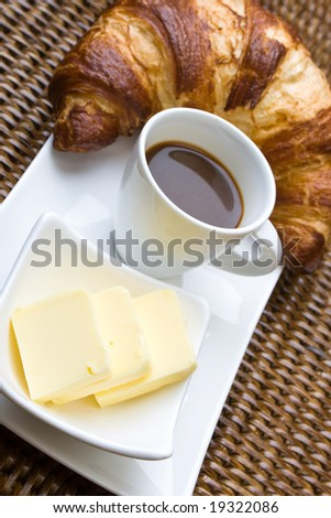 Coffee and croissant with butter