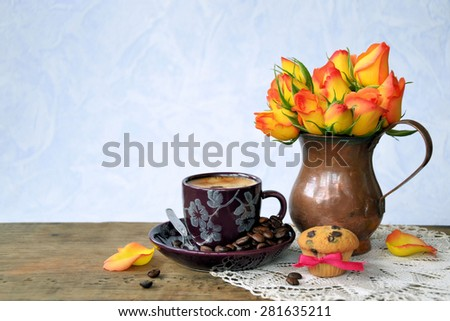 coffee and flowers on a blue background