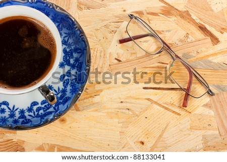 Coffee and glasses over a wood board