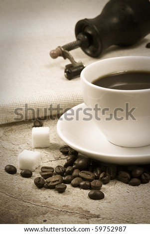 coffee and grinder on sepia