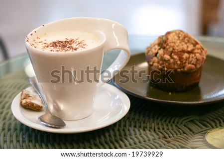 Coffee and muffin. - stock photo