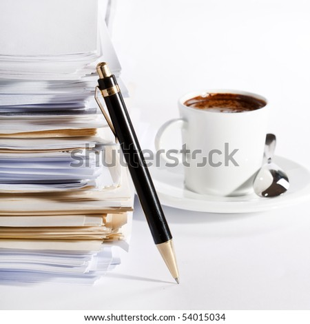 coffee and stack of paper