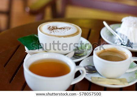 Coffee and tea in cup on table #578057500