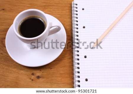 Coffee and writing pad. Looking for inspiration