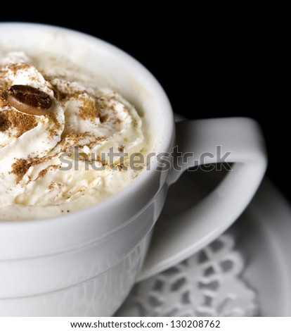 Coffee background and white cup isolated in black - stock photo
