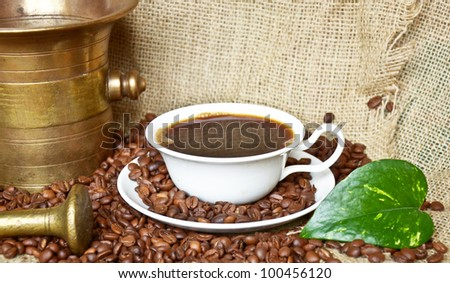 Coffee background - Coffee mill with cup and beans