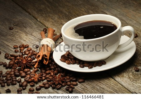 Coffee background with beans and white cup.