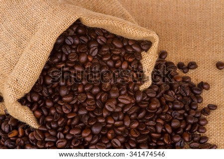 Coffee bag - coffee beans in canvas coffee sack isolated on canvas background #341474546