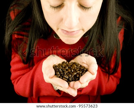 coffee bean aroma, woman smelling coffee beans in her hands