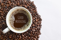 Coffee bean brown roasted and a cup of coffee with text GOOD MORNING