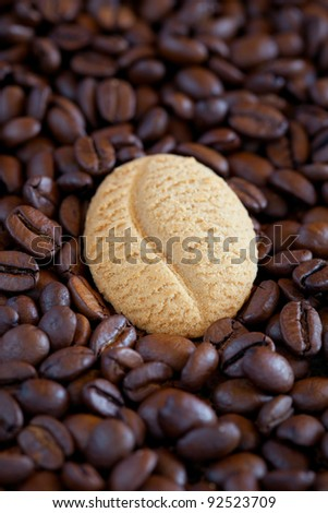 Coffee bean cookie on coffee beans, selective focus