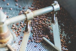 coffee bean roaster machine equipment working for beverage business job, roasting preparation process for coffee cafe, aromatic brown coffee roasted, aroma espresso hot drink