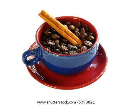 Coffee beans and a cinnamon stick with a colorful cup isolated on a white background