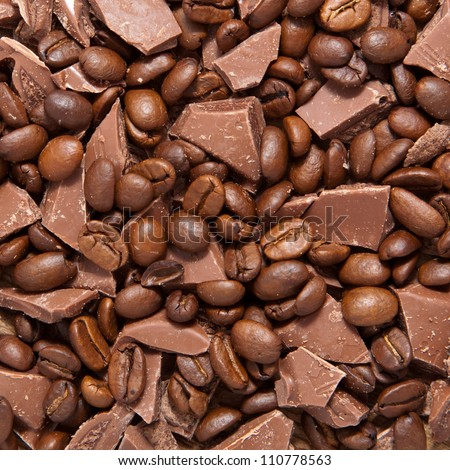 Coffee beans and broken pieces of milk chocolate. Delicious food background