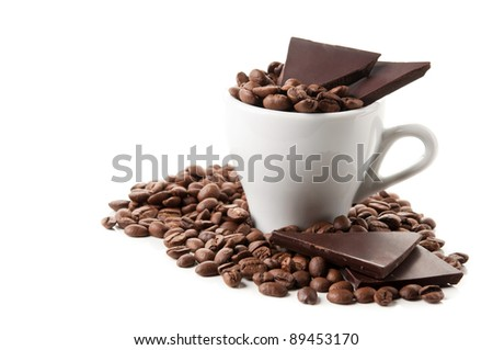coffee beans and chocolate isolated on a white background