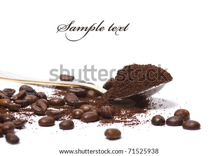 Coffee beans and cocoa in spoon isolated ovtr white