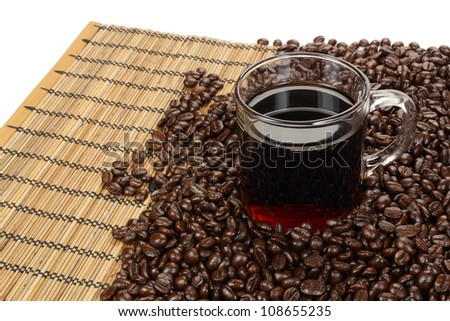 coffee beans and coffee cup on a mat