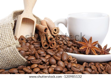 Coffee beans and coffee cup with cinnamon sticks