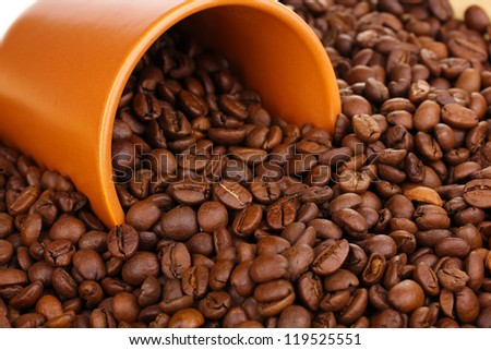 Coffee beans and cup close-up