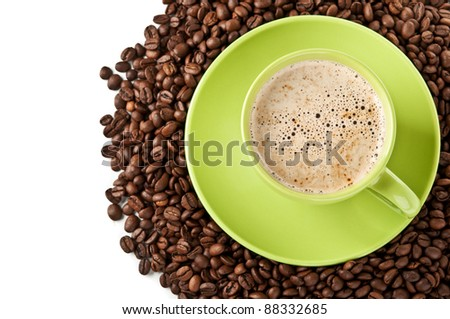 coffee beans and green cup of cappuccino isolated on a white background