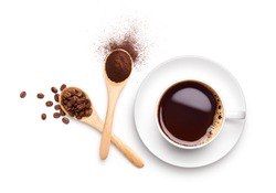 Coffee beans and ground coffee on wooden spoon with cup of black coffee over white background