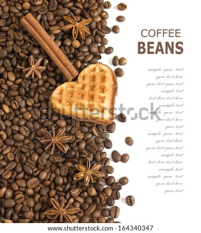 Coffee beans and heart cakes isolated on white background isolated on white with sample text. Valentine day concept