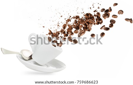 coffee beans and powder spilling out of a cup isolated on white #759686623