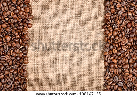 Coffee beans and sackcloth background