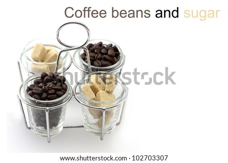 Coffee beans and sugar in glass