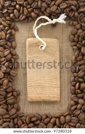 coffee beans and tag price label on wood background texture