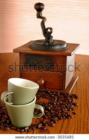 coffee beans, antique grinder and cups